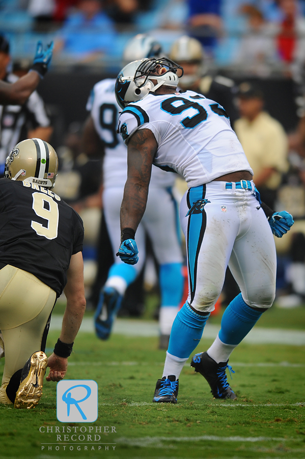 Panther Antwan Applewhite (93) lets out a roar after sacking Drew Brees