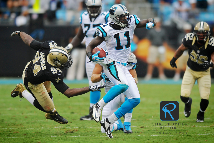 Panther receiver Brandon LaFell (11), who had a big game, picks up yardage after a catch