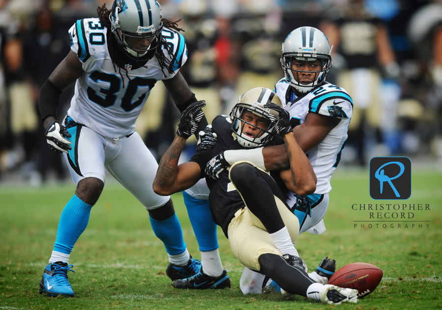 Panther cornerback Josh Norman puts a hit on a Saint receiver