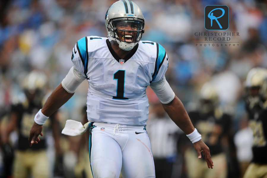 Quarterback Cam Newton celebrates a Carolina touchdown