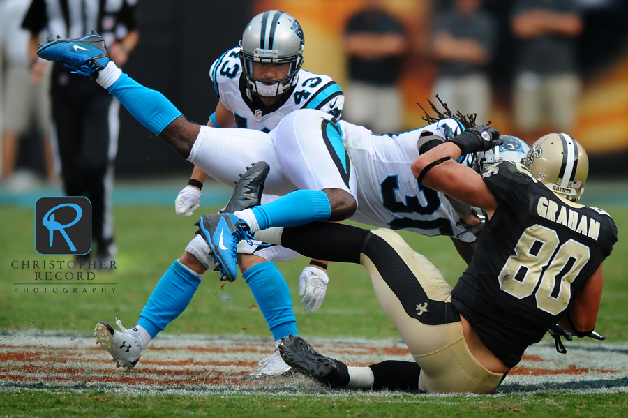 Carolina's Charles Godfrey puts a big hit on Saint receiver Jimmy Graham