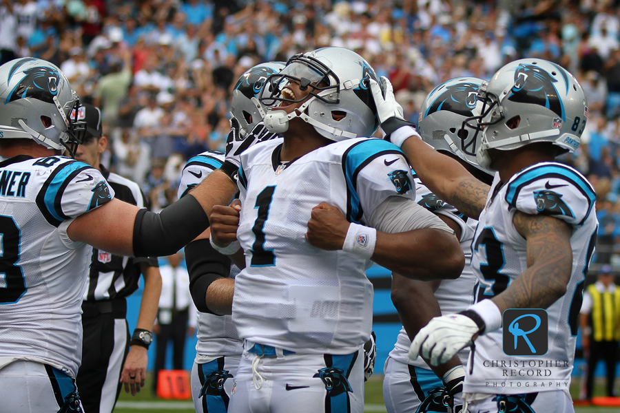 """Superman"" emerges as Cam Newton scores a late touchdown"