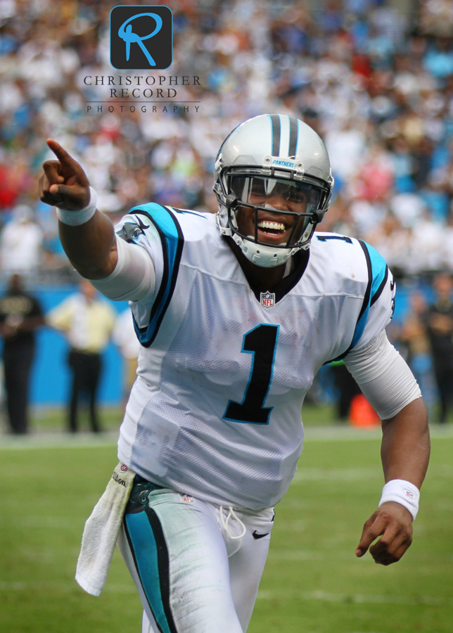 Cam Newton celebrates with the fans