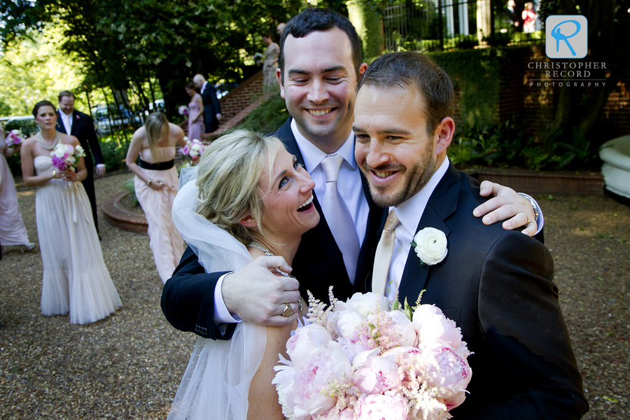 Cameron hugs his sister and new brother-in-law
