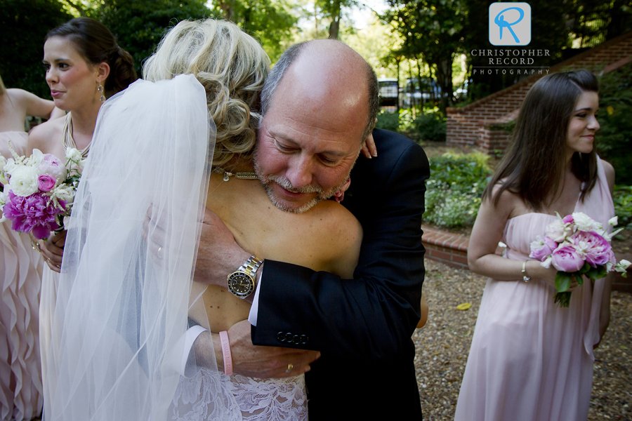 A big hug from her father