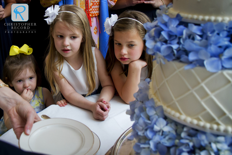 The flower girls gave the cake their full attention