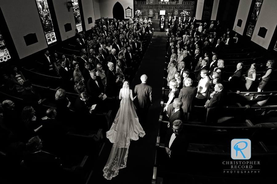 Striking light as the bride enters from Laura's angle in the balcony