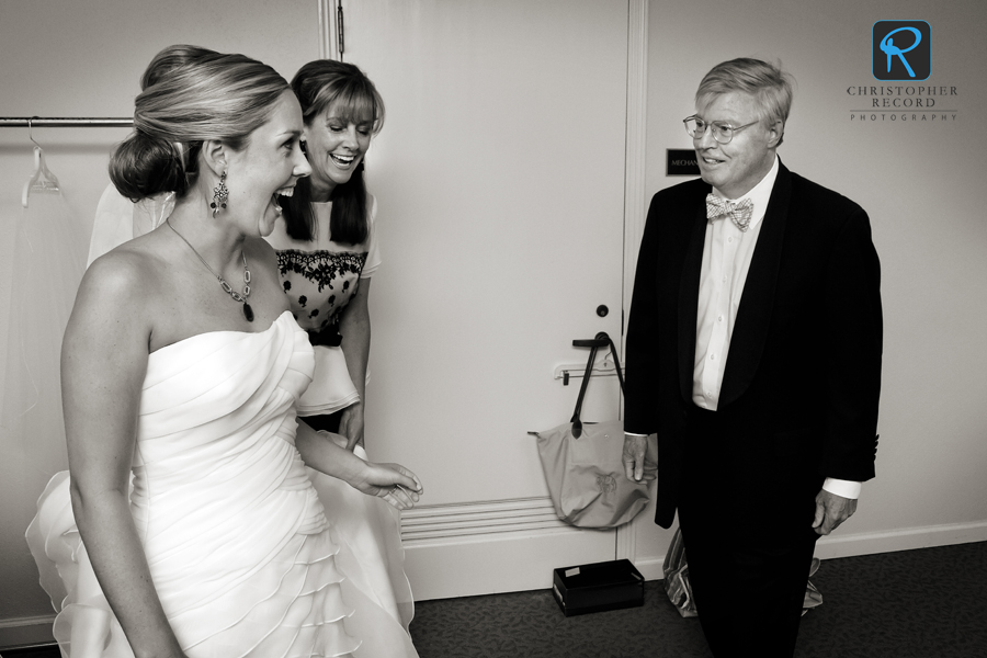 Sarah Dorsett's father Ken gets a glimpse of the bride as her mother Rush looks on