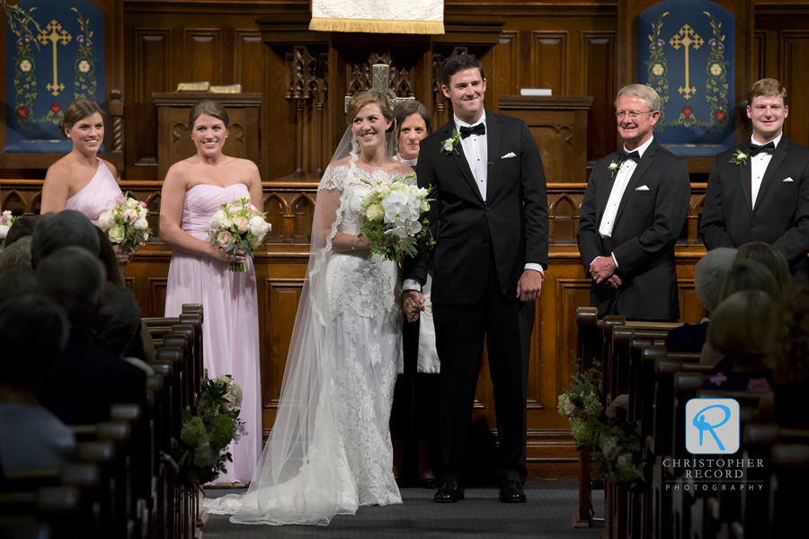 The Rev. Katherine Cooke Kerr has the couple turn to see their family and friends