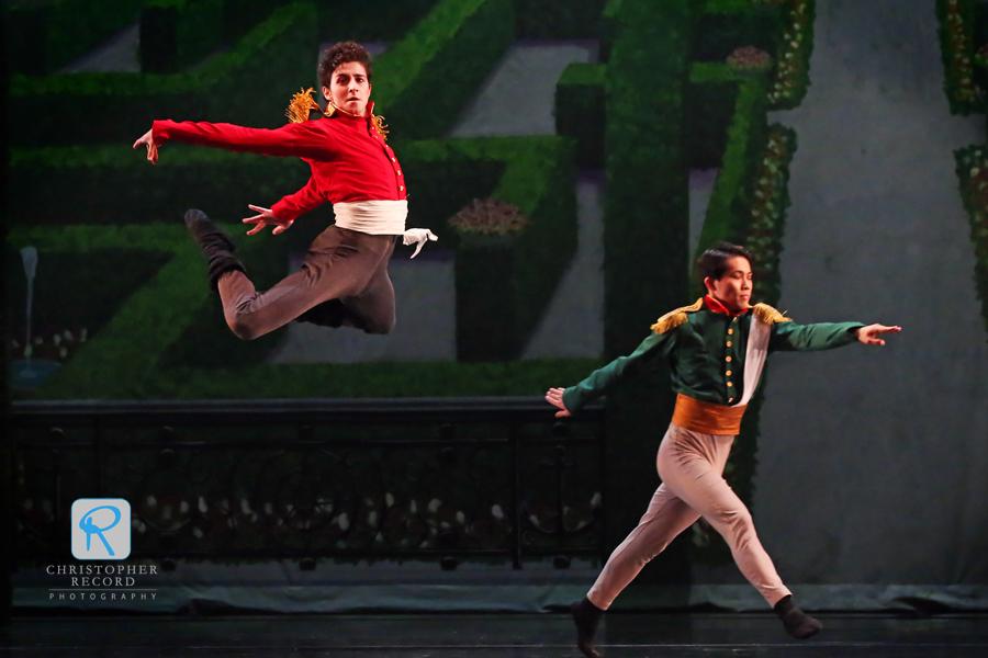 Iago Bresciani leaps as Ryo Suzuki looks on