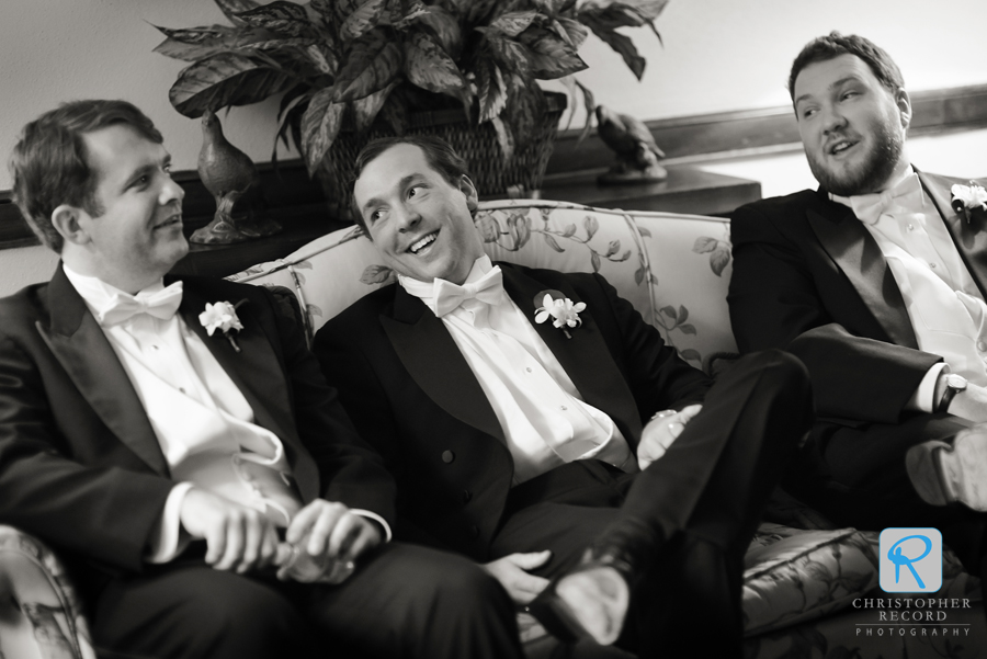 The groomsmen, including Caroline's brother, relax
