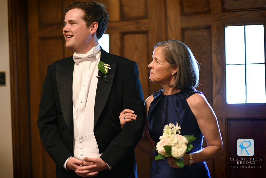 Bryan escorts his mother Gibbs