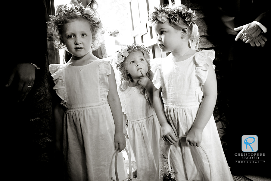 The flower girls get ready for their moment, in a capture from Laura