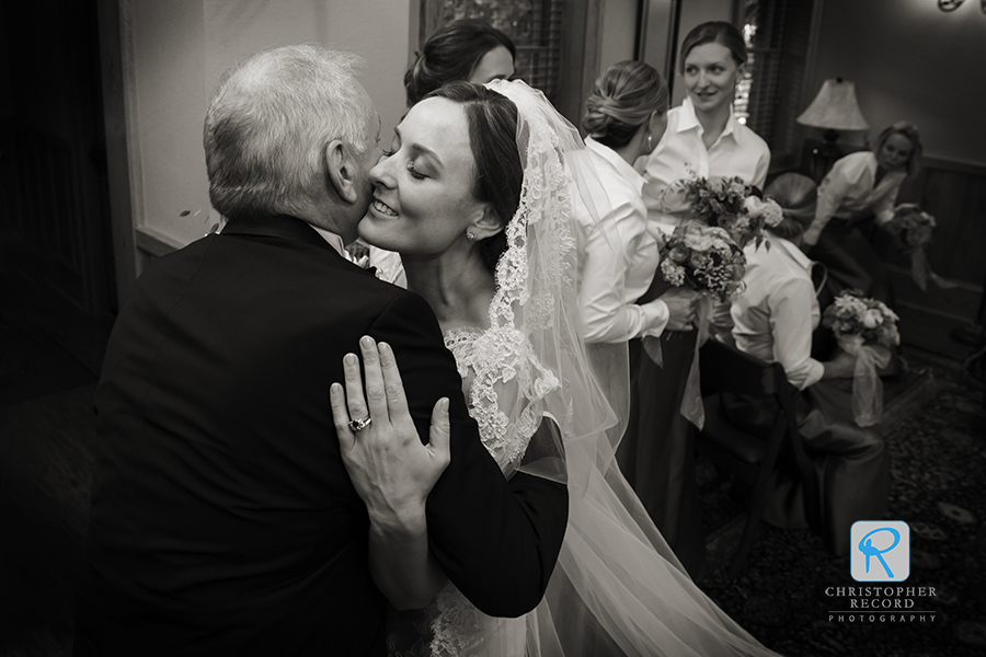 A kiss from her father